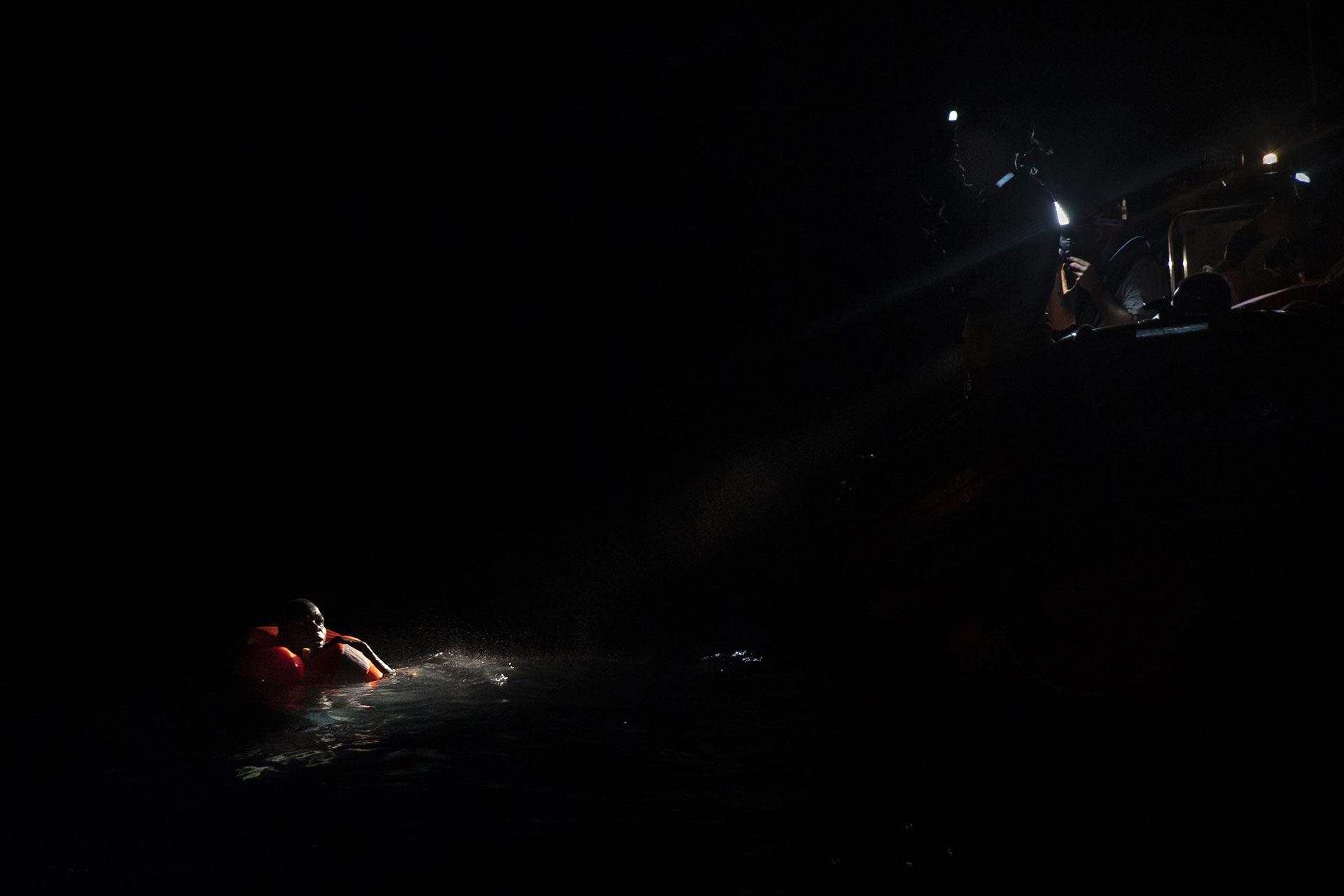 Mohamed, 17, from The Gambia, floating in the water during a search and rescue operation organised by the NGO Proactiva Open Arms on 2 August 2018.