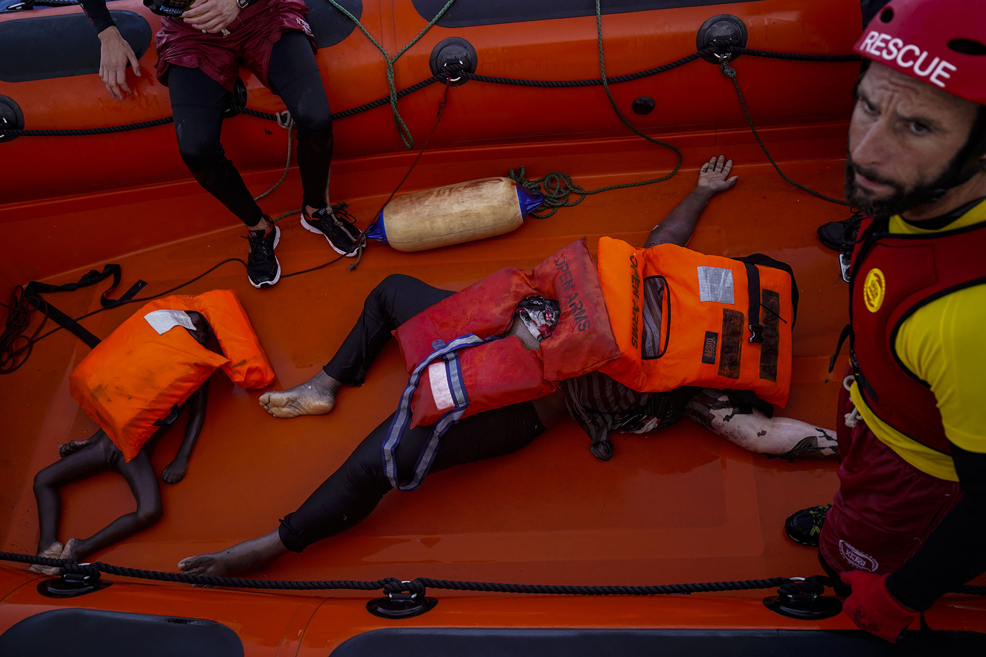The bodies of a young boy and a woman remain on the deck of one of the boats after the rescue operation by Proactiva Open Arms in the central Mediterranean Sea, 17 July 2018.
