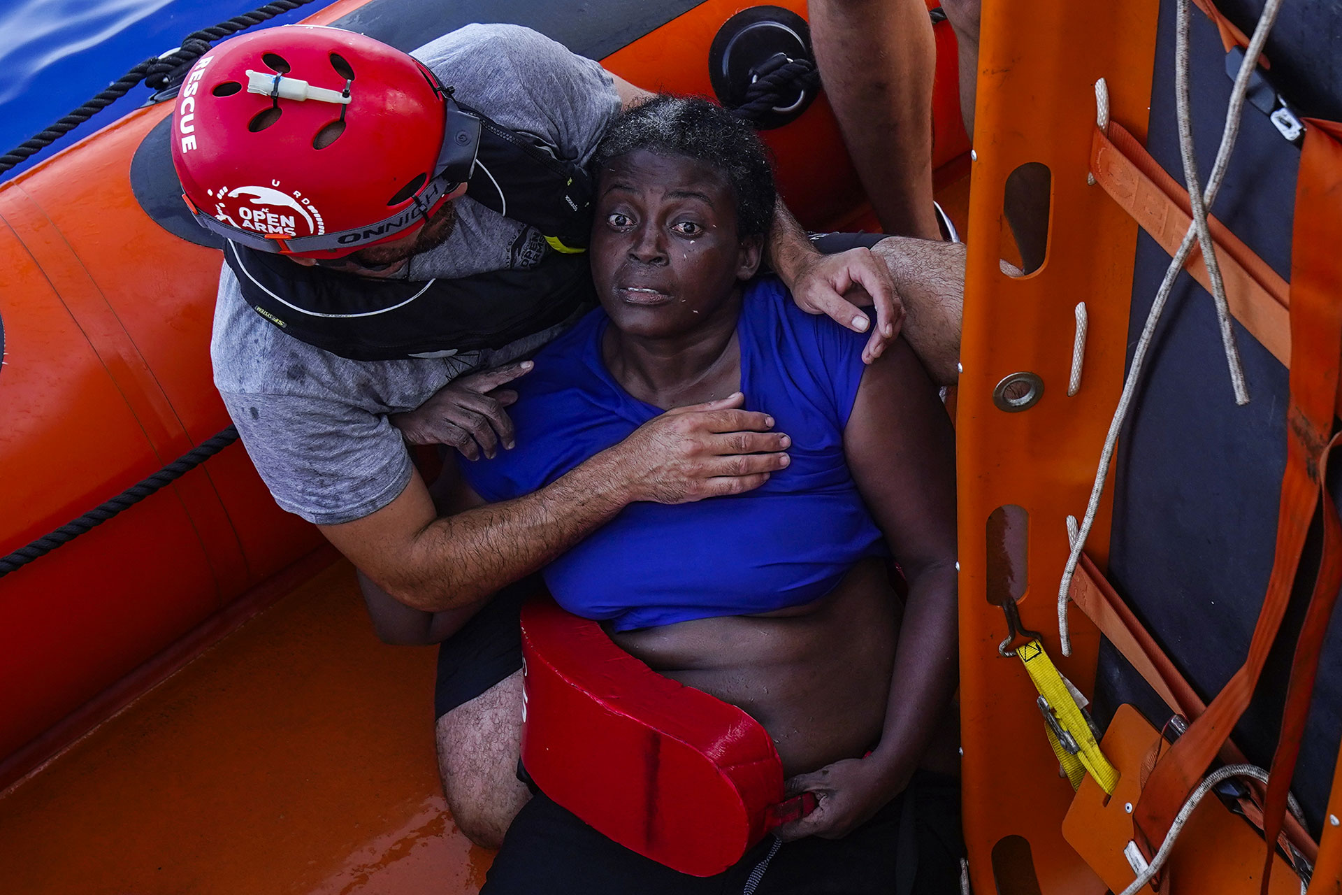 A crew member of the rescue ship from the Spanish NGO Proactiva Open Arms embraces Josepha (Cameroon) in the central Mediterranean Sea, 17 July 2018.