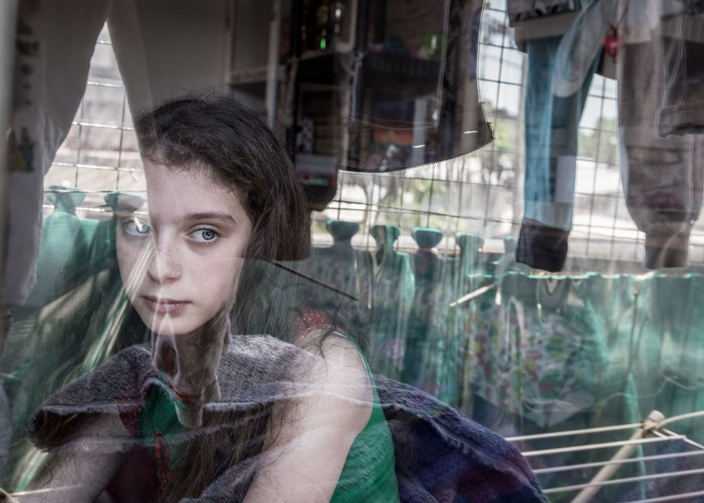 Rivka Schiller, 11 years, in her house. Her mother was victim of many death threats by her ex husband. She had filed 45 complains to the police without getting any protection from them. He also attempted to strangle her in front of her daughters. They live in a kind of prison.