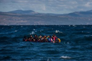 Scores of Afghan refugees approach the coasts of the Greek island of Lesbos on board an unstable plastic boat which is about to sink.
