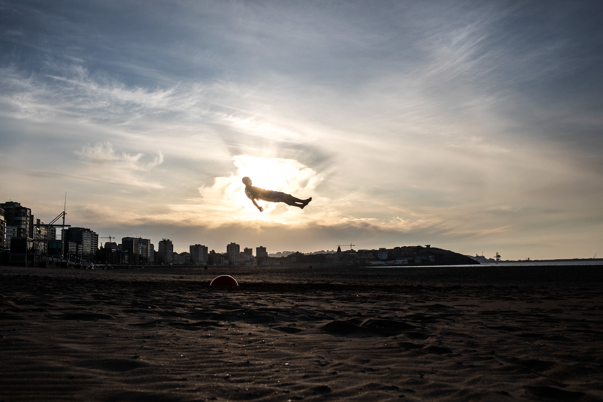 A young man is seen on the air while doing stunts on San Lorenzo beach during the period authorized by the government to play sports during phase one of de-confinement in Gijón, Asturias, Spain. May 19, 2020.