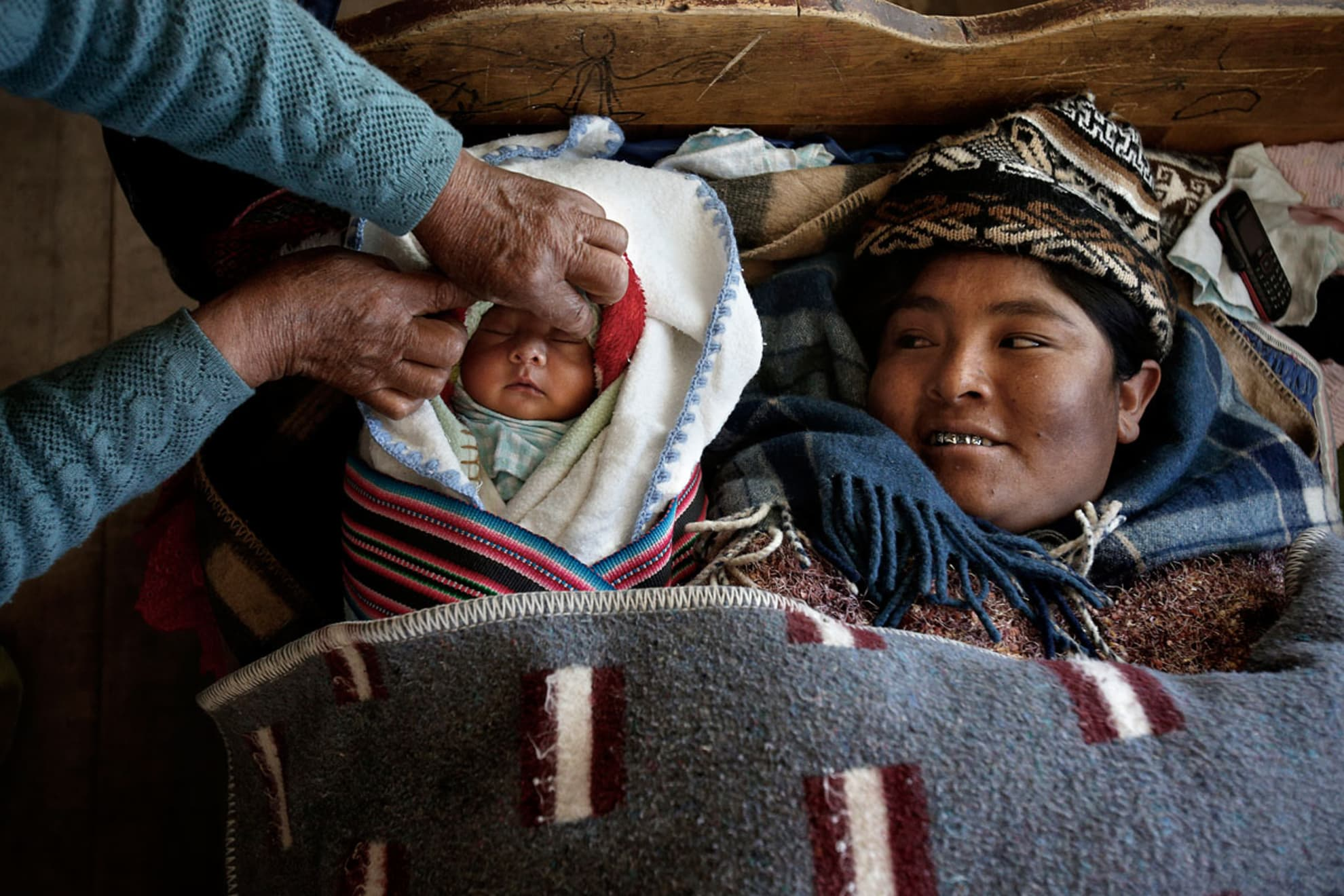 Zenobia Mamani Ramos, 38 years old, rests at home a few days after giving birth.