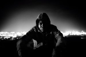 Narcisse, from Cameroon, moments before attempting to jump the fence. In the background, the city lights of Melilla. Narcisse was able to cross over to Melilla that night.