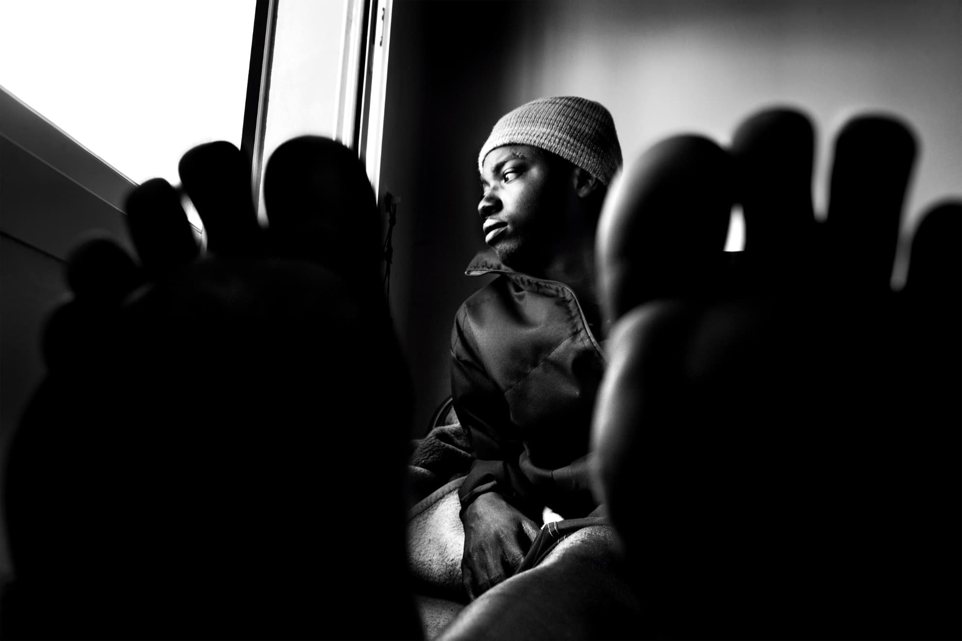 Mohamed, from the Gambia, waits to recover in the hospital in Nador. He broke his foot while attempting to jump the fence between Morocco and Melilla.