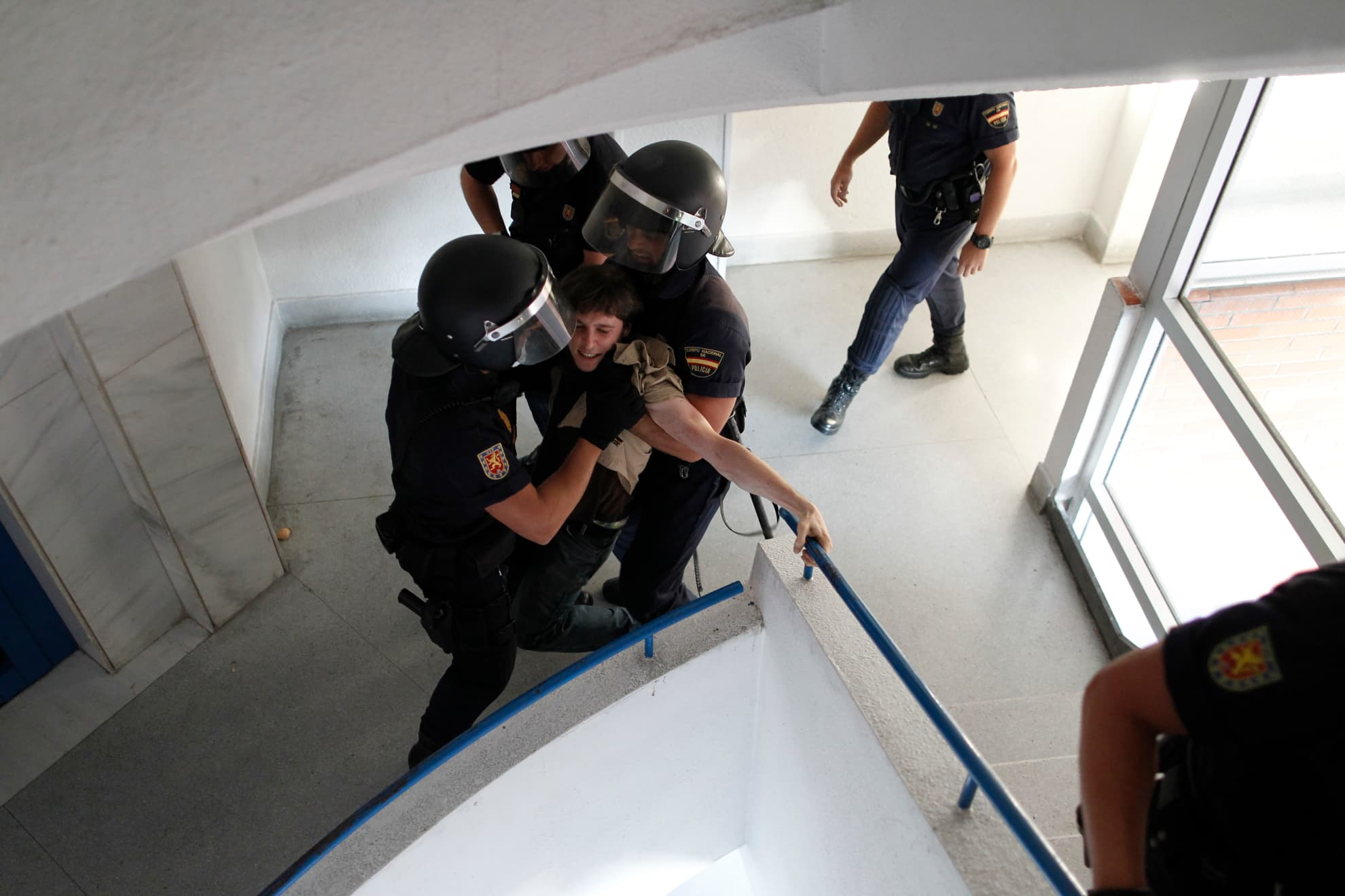 Police remove activists as they try to stop the eviction of Susana Montoya in Madrid, Wednesday, July 24, 2013. Montoya and her husband have two children and have occupied an apartment of the City Hall Housing Company for the past year, as they could not afford to pay rent.