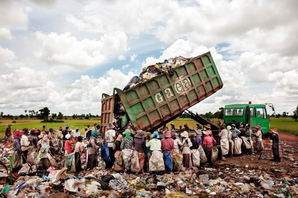 A truck loaded with waste arrives at the Siem Reap rubbish dump in Cambodia. It is estimated that 20 minors work with their families there.