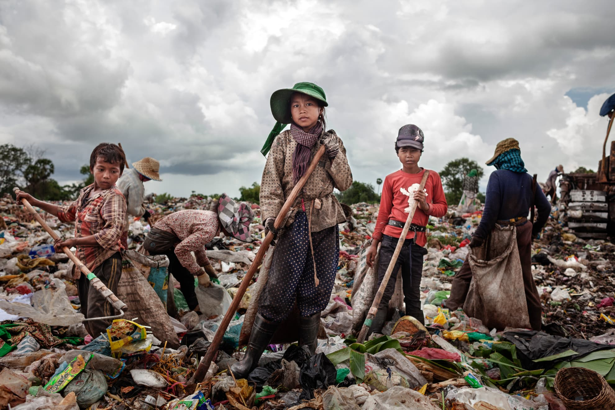Sueun Chany, aged 14, began working at the dump at the age of 14. There are seven people in her family. In the future, she would like to be a teacher.