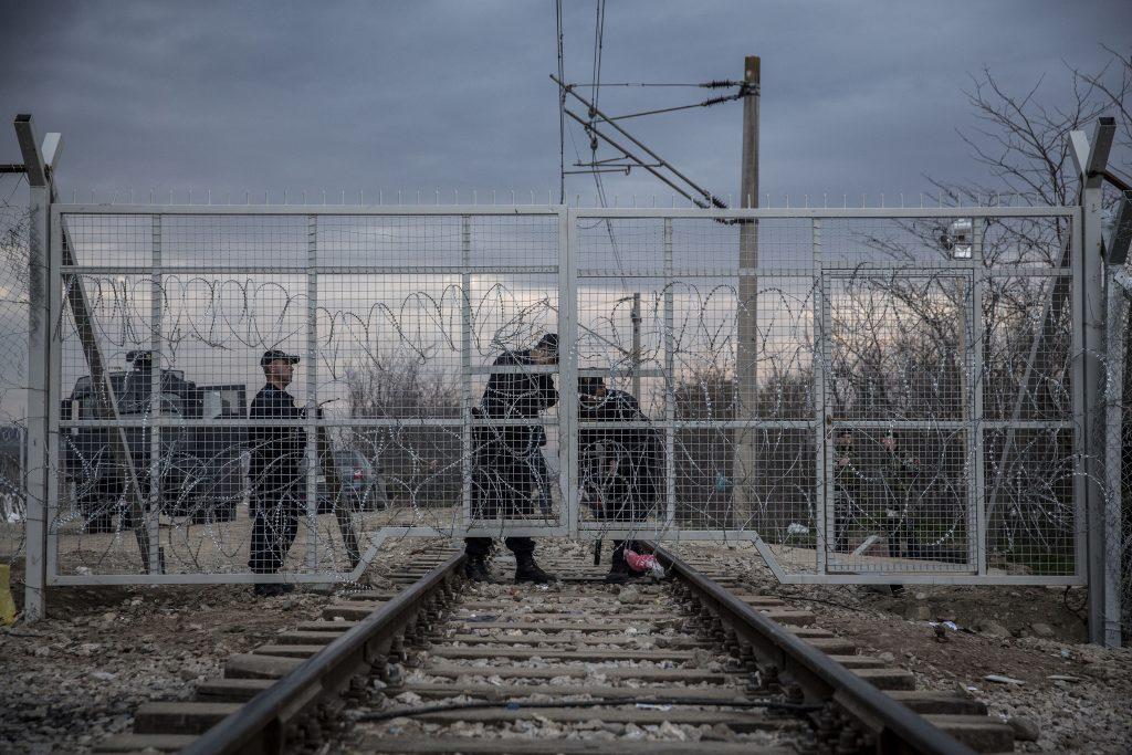 Macedonian police closing the gate which separate Macedonia and Greece. Idomeni, 03/03/2016