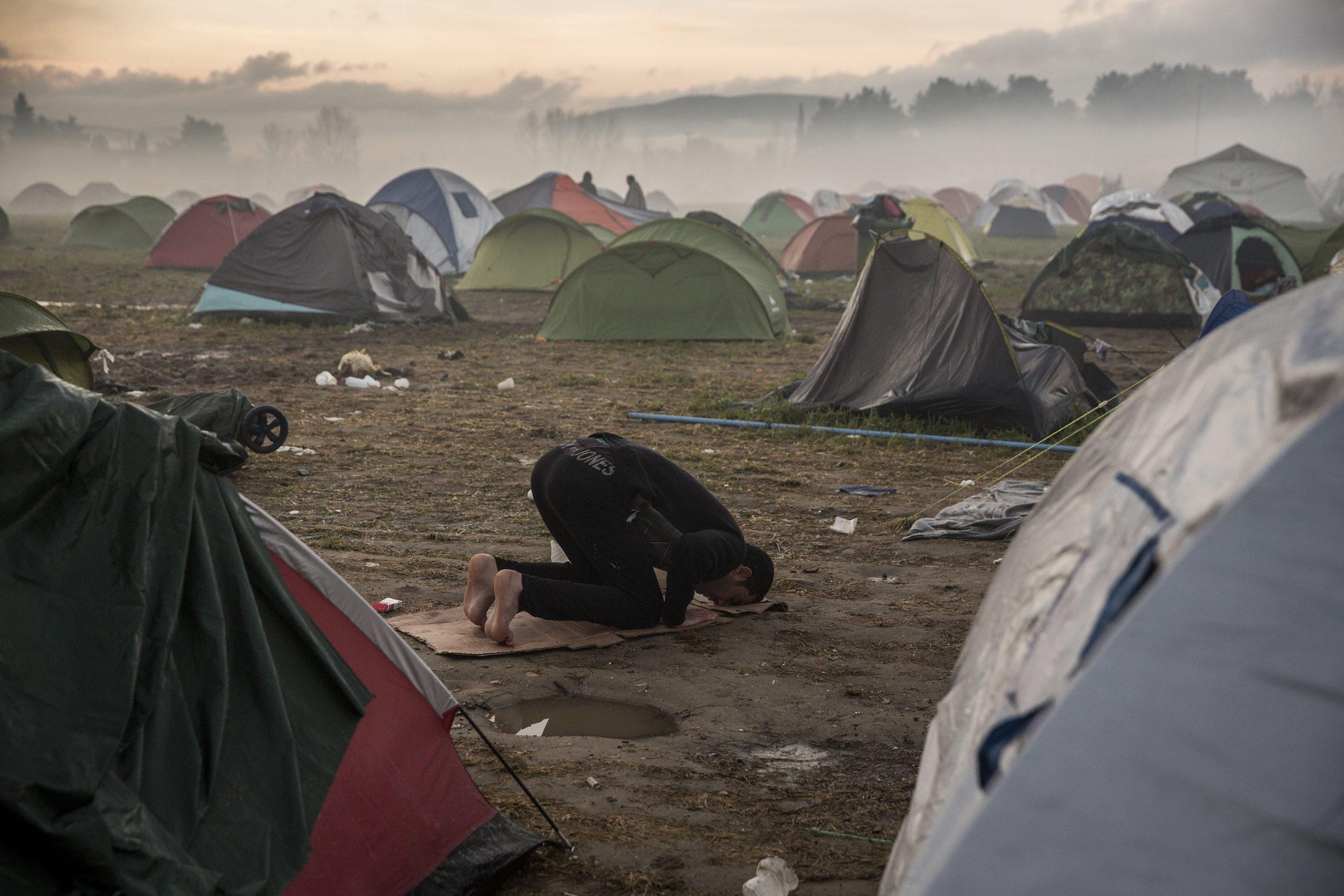 A refugee praying at sunrise. Idomeni. 08/03/2016