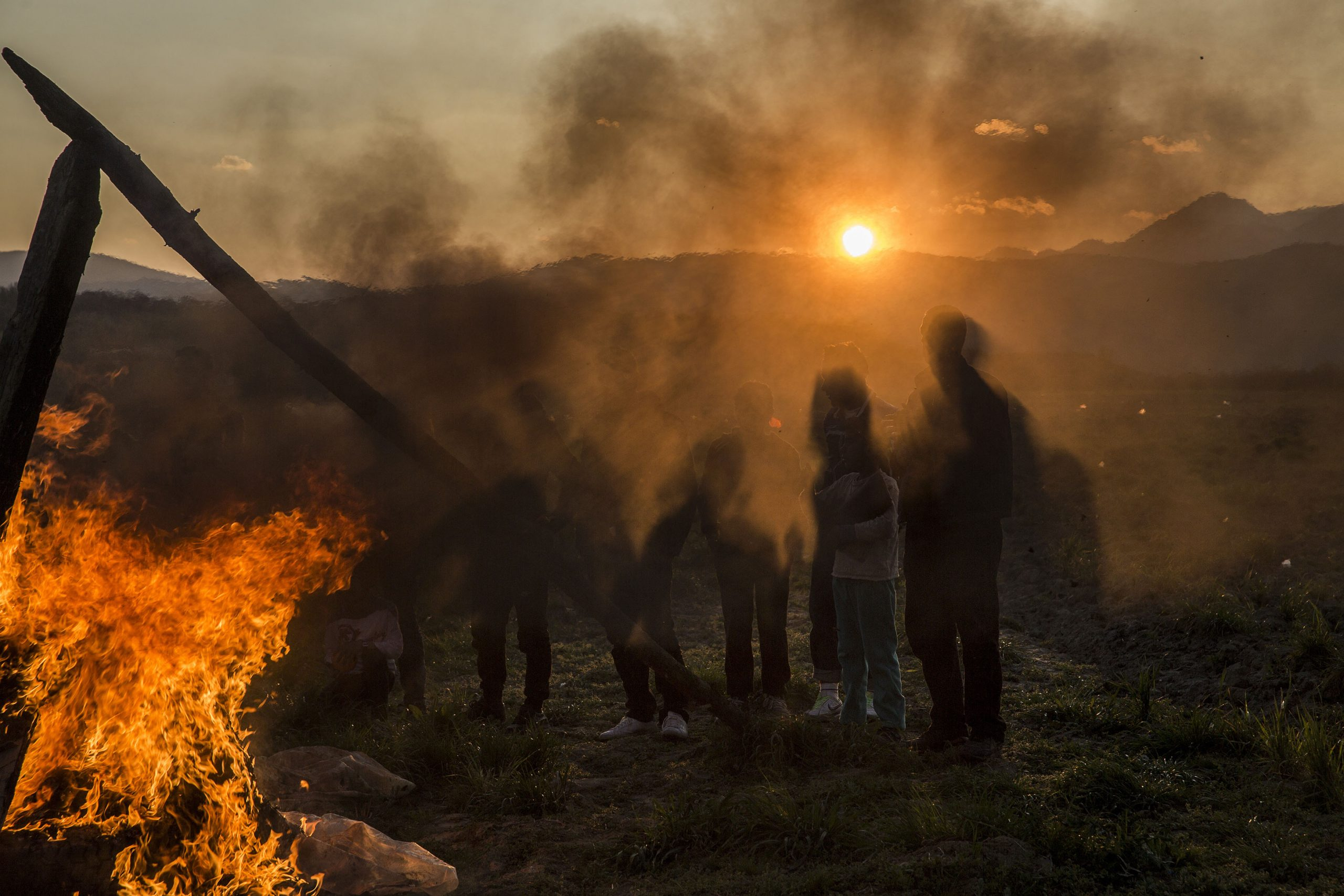 Some Kurdish refugees celebrating the Newroz, the Kurdish new year. Idomeni, 20/03/2016