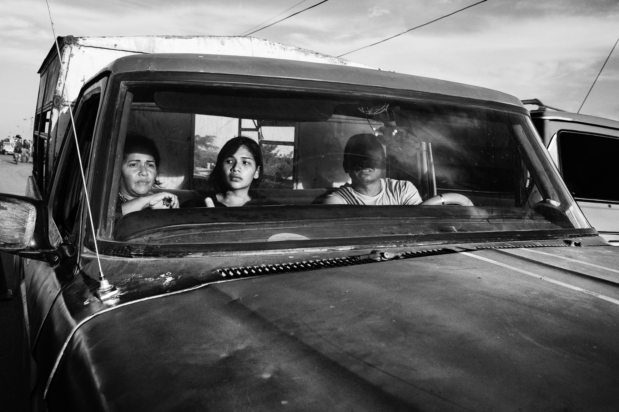 Migrants sit in a truck at the border town of Paraguachón, Colombia, waiting for a ride to the major city of Maicao.