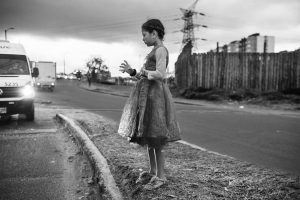 A young girl asks for money on a street in the Colombian capital, Bogotá. By June 2019, the Colombian Institute of Family Welfare (ICBF) had provided attention to nearly 80,000 Venezuelan children, adolescents and families countrywide.