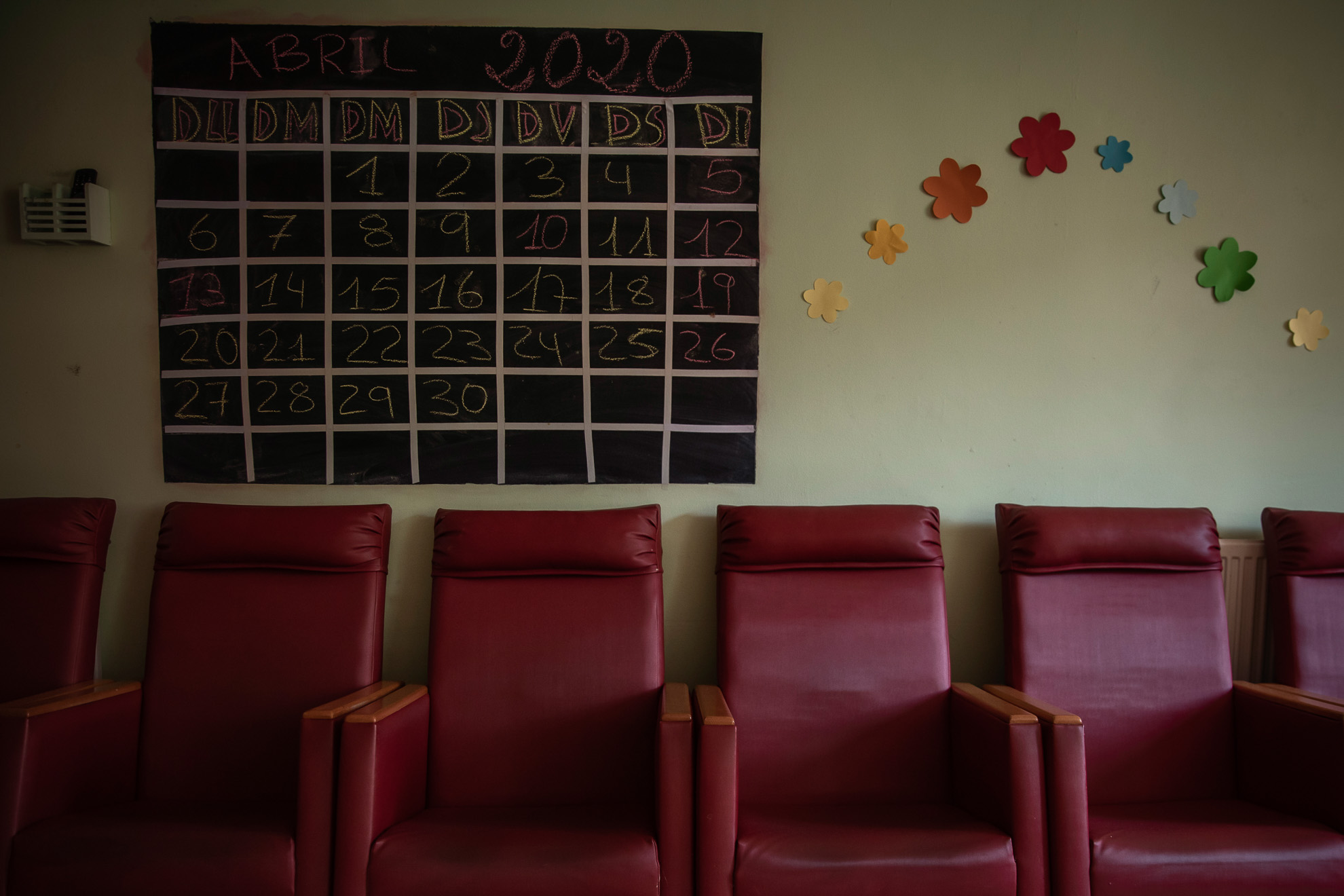 Armchairs remain empty in the leaving room of a nursing home, during the weeks in which elders had to keep confined to their rooms, province of Barcelona, ​​Spain, April 15, 2020.