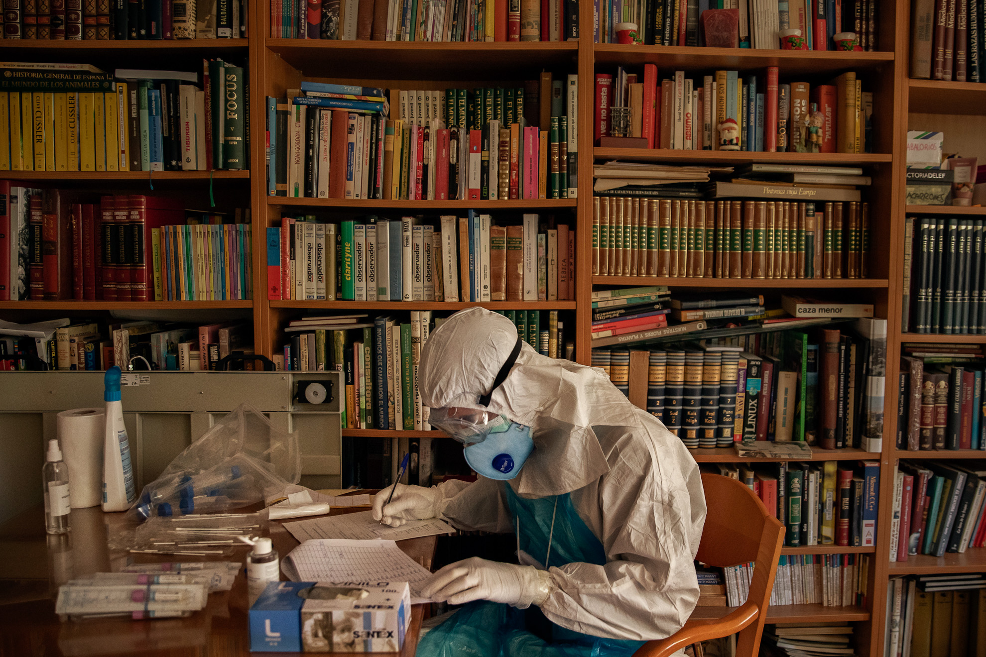 A volunteer of the Spanish NGO Open Arms prepares PCR tests for the detection of coronavirus at a nursing home during the worst weeks of lockdown, province of Barcelona, ​​Spain, April 15, 2020.